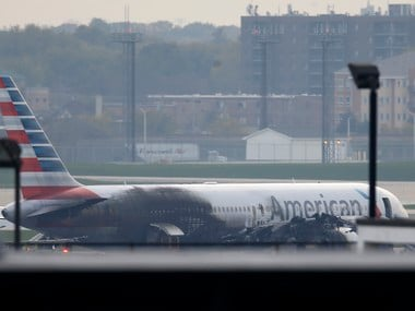 Soot covers the fuselage of an American Airlines jet that that caught fire at O'Hare International Airport in Chicago on 28 October. Reuters