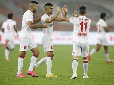 Delhi Dynamos players celebrate their side's goal against FC Pune City. ISL