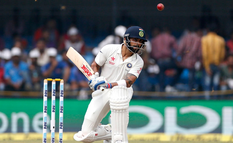 Indian cricket team captain Virat Kohli bats on the first day of their third cricket test match against New Zealand in Indore, India, Saturday, Oct. 8, 2016. (AP Photo/Rafiq Maqbool)