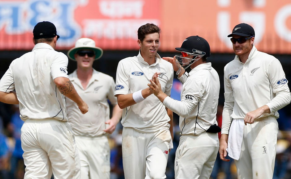 New Zealand's players celebrate the wicket of Indian batsman Cheteshwar Pujara on the first day of their third cricket test match against India in Indore, India, Saturday, Oct. 8, 2016. (AP Photo/Rafiq Maqbool)