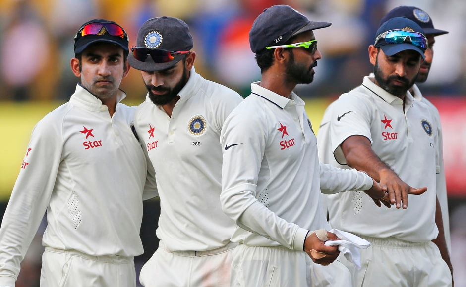 Indian players walk back to the pavilion at the end of the second day of the third test cricket match between India and New Zealand in Indore, India, Sunday, Oct. 9, 2016. (AP Photo/Rafiq Maqbool)