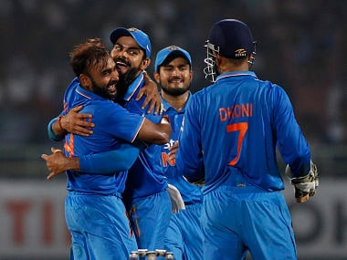 India's Amit Mishra celebrates with teammates after taking the wicket of New Zealand's Ross Taylor during their fifth and last ODI match in Visakhapatnam. AP