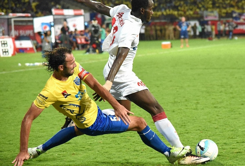 Kerala Blasters and Delhi Dynamos players in action. PTI