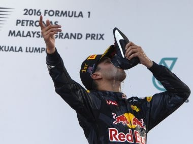 Daniel Ricciardo drinks champagne from his shoe as he celebrates winning the Malaysian GP. AP