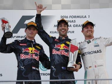 Red Bull's Daniel Ricciardo, teammate Max Verstappen and Mercedes' Nico Rosberg  after winning the Malaysian GP. AP