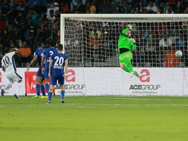 Richarlyson Felisbino (left) of FC Goa scores a goal past Mumbai City FC goalkeeper Roberto Volpato. ISL