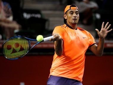 Nick Kyrgios returns the ball during the match against Gael Monfils. Reuters