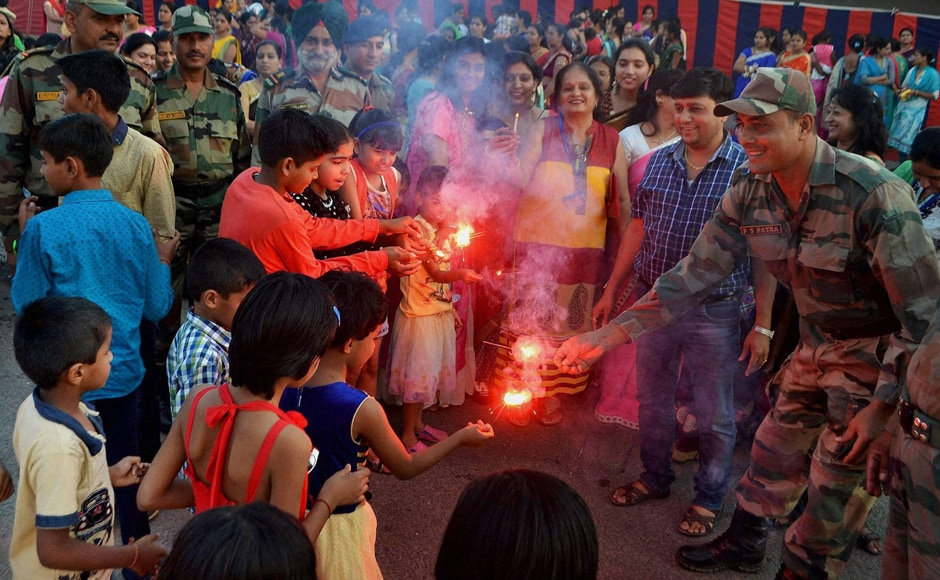 Children celebrated Diwali with soldiers at Army Cantonment area near Beawar, Rajasthan. (Photo: PTI)
