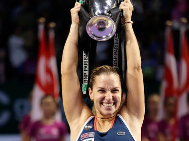 Dominika Cibulkova of Slovakia celebrates after beating Angelique Kerber of Germany in their women's singles final match at WTA finals. AP