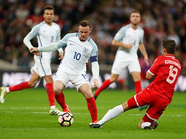England's Wayne Rooney vies for the ball with Malta's Bjorn Kristensen during the World Cup Group F qualifying match. AP