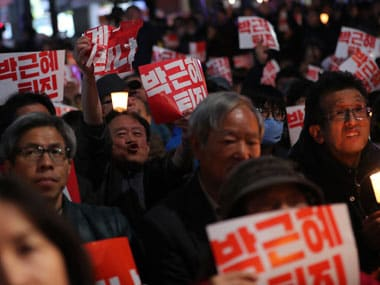 South Koreans hold signs during a rally calling for President Park Geun-hye to step down in downtown Seoul, South Korea, Saturday, 29 October, 2016. AP