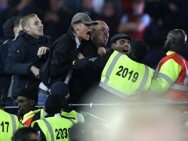 Supporters and stewards clash during the League Cup match between West Ham United and Chelsea. AP