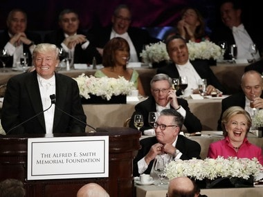 Republican presidential candidate Donald Trump, left, speaks at the 71st Annual Alfred E. Smith Memorial Foundation Dinner as Democratic presidential candidate Hillary Clinton, right, watches, Thursday, Oct. 20, 2016, in New York. (AP Photo/Frank Franklin II)