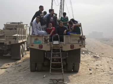 People moving out of Mosul. AP