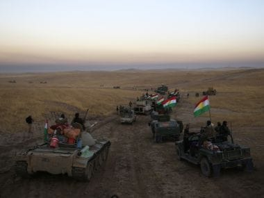 A Peshmerga convoy drives towards a frontline in Khazer, about 30 km east of Mosul, Iraq. AP