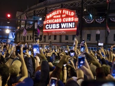 Chicago fans celebrate the Chicago Cubs 8-7 victory over the Cleveland Indians. AFP
