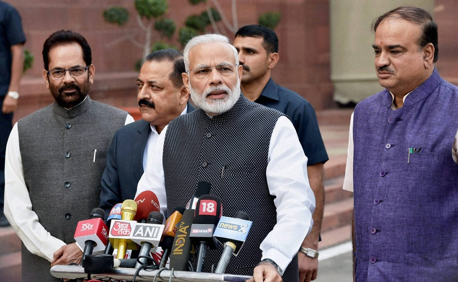 Prime Minister Narendra Modi with Parliamentary Affairs Minister Ananth Kumar and MoSes Jitendra Singh and Mukhtar Abbas Naqvi addresses the media on the opening day of the winter session of Parliament in New Delhi on Wednesday. PTI Photo by Shahbaz Khan (STORY DEL9) (PTI11_16_2016_000022B)