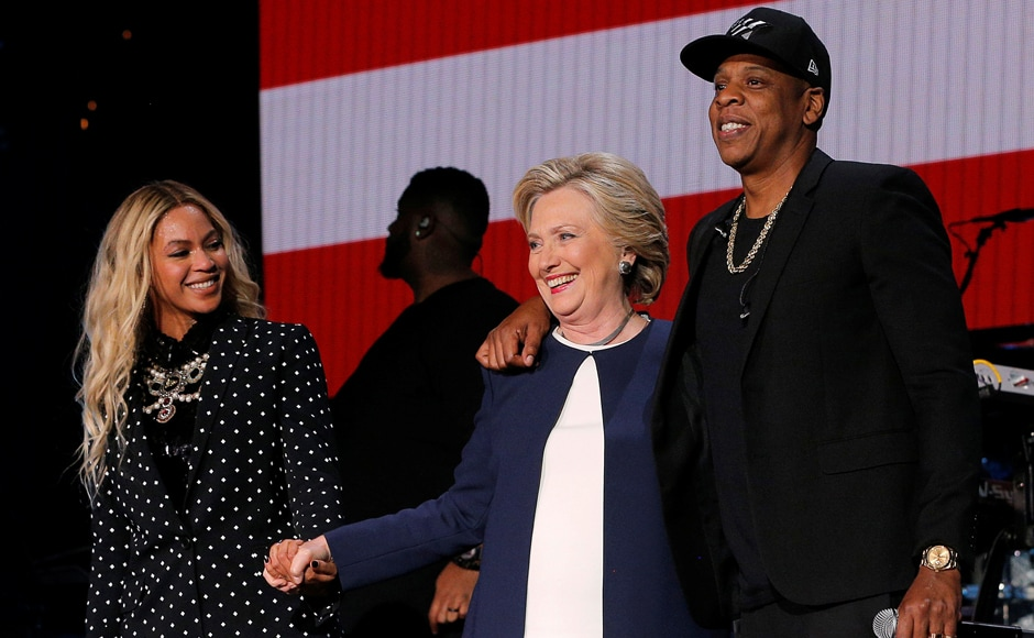 Hillary Clinton joins Jay Z and Beyonce onstage at the campaign concert in Cleveland, Ohio. Reuters