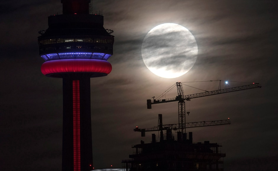 The supermoon sets behind the CN tower in Toronto on Monday. The Canadian Press via AP