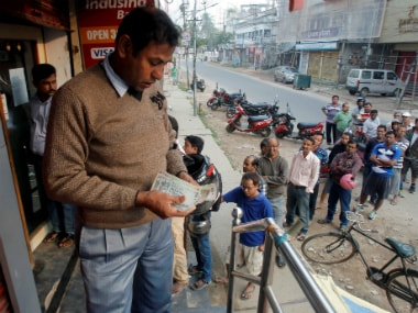 A file image of people standing at an ATM queue. Reuters
