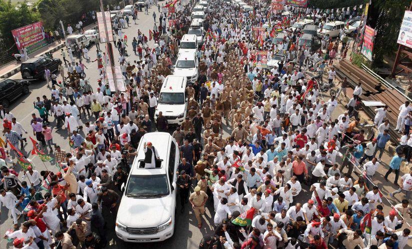 Uttar Pradesh Chief minister Akhilesh Yadav waving at crowd during his Vikas Rath Yatra that was flagged off on Thursday in Lucknow. PTI