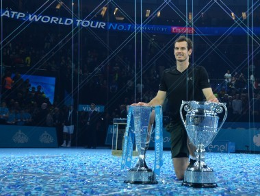 Andy Murray poses with both the ATP World Number One trophy and the ATP World Tour Finals trophy. AFP