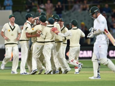 Australia players celebrate Kyle Abbott's wicket. AFP