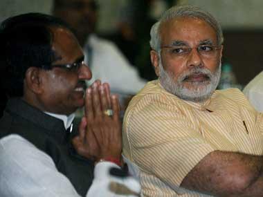 Shivraj Singh Chouhan and Narendra Modi. AFP file image