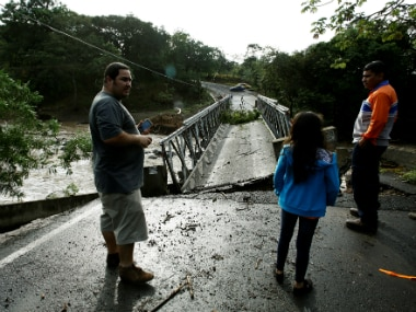 People gather near a  bridge destroyed by Hurricane Otto in Guayabo de Bagaces, Costa Rica on Thursday. Reuters