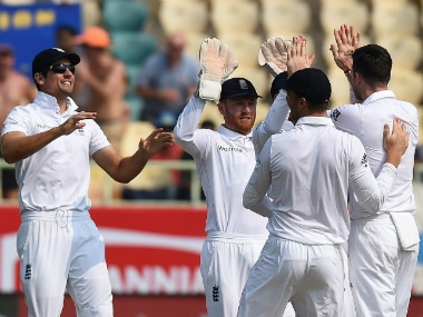 The England team celebrating the wicket of Murali Vijay. AFP