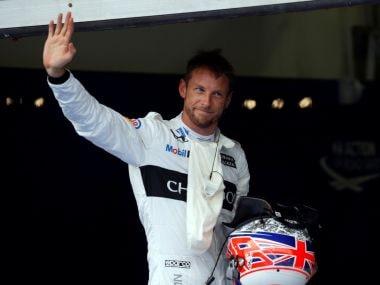 McLaren's Jenson Button of Britain waves to his fans. Reuters