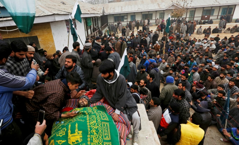People gather around the body of Rayees Ahmad Dar, a suspected militant who according to local media was killed in an encounter with the armed forces in Pulwama district a few days back, at his funeral in Kakapora village, south of Kashmir. Reuters