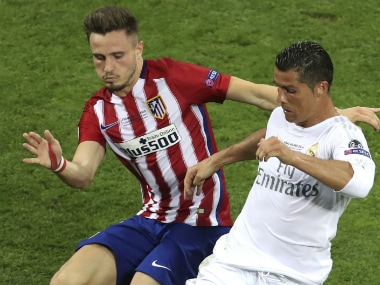 Atletico's Saul and Real Madrid's Cristiano Ronaldo vie for the ball. AP