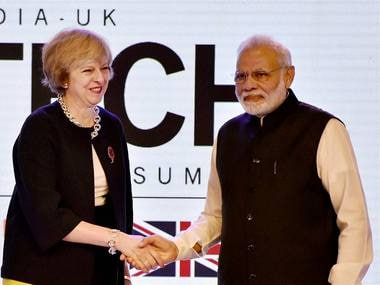 PM Narendra Modi with UK counterpart Theresa May in New Delhi. PTI
