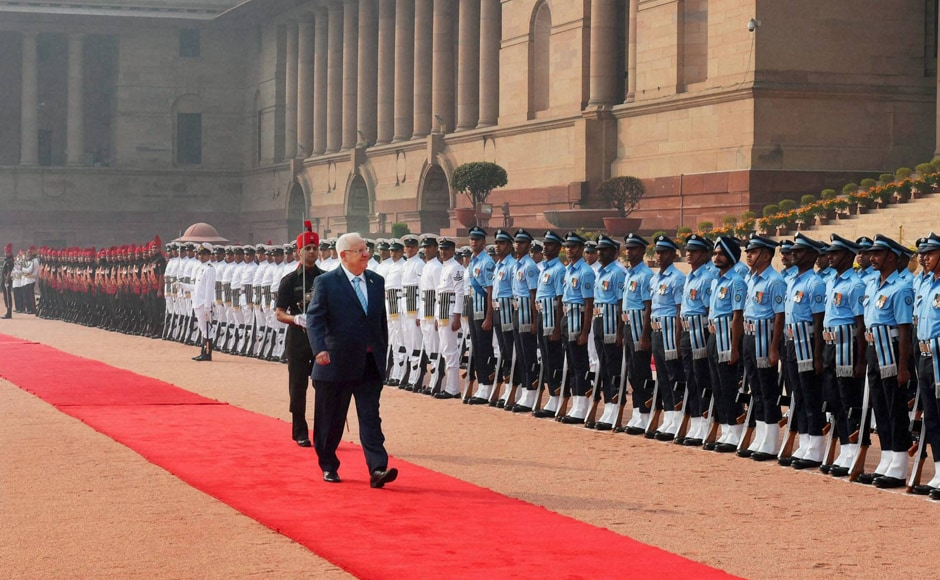 Israeli President Reuven Rivlin inspects the guard of honor during a ceremonial welcome at Rashtrapati Bhavan in New Delhi on Tuesday. PTI
