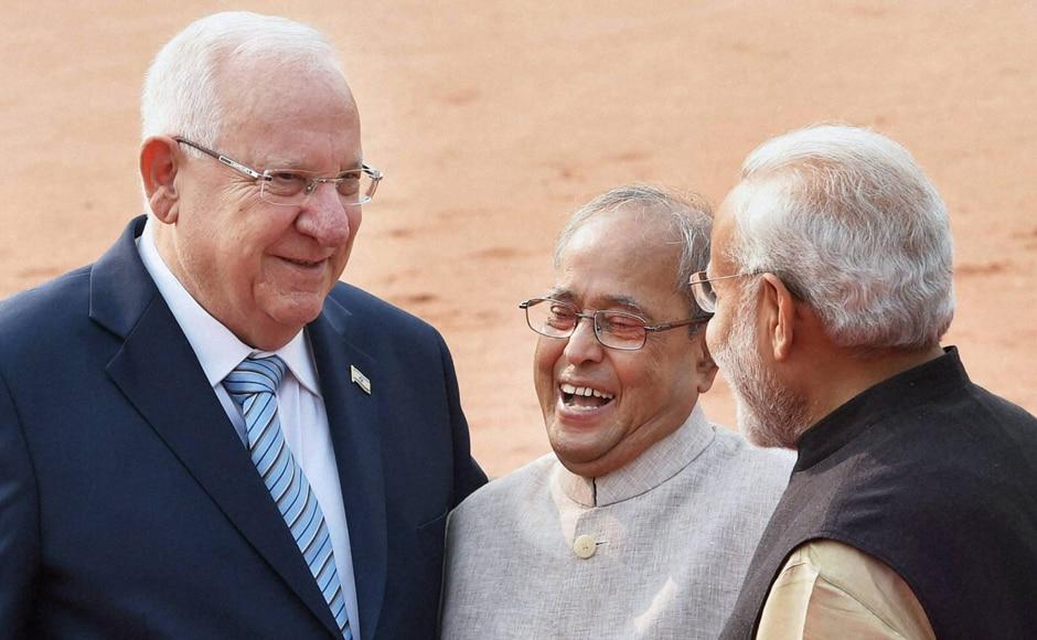 President Pranab Mukherjee, Prime Minister Narendra Modi and Israeli President Reuven Rivlin share a light moment during a ceremonial welcome at Rashtrapati Bhavan in New Delhi on Tuesday. PTI