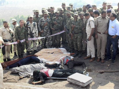 Police at the encounter site at the hillocks of Acharpura village after the STF killed 8 Students of Islamic Movement of India (SIMI) activists. PTI