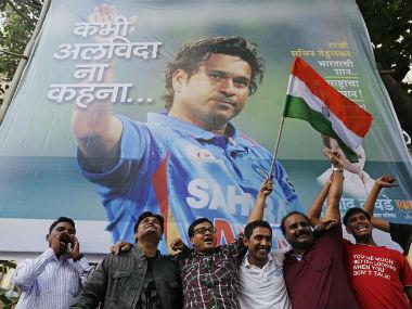 Fans in front of a billboard of Sachin Tendulkar in Mumbai before his last international match. Reuters
