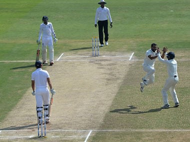 Mohammad Shami (2R) celebrates the wicket of Alastair Cook in second Test. AFP