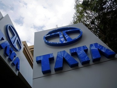 Tata Motors logos are seen at their flagship showroom before the announcement of their Q3 results in Mumbai February 14, 2013. REUTERS/Vivek Prakash/File Photo - RTX2QABF