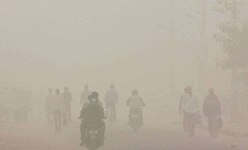 People walking through smog due to increase in air pollution after Diwali celebrations in Gurgaon on Thursday. PTI