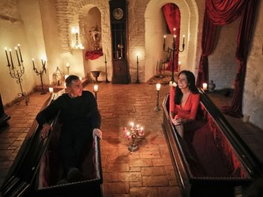 Tami Varma (right) with her brother Robin in coffins at the Bran Castle, in Bran, Romania on Monday. AP