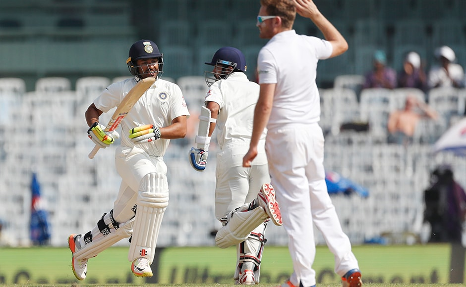 India's Karun Nair, left, runs between the wickets during their fourth day of the fifth cricket test match against England in Chennai, India, Monday, Dec. 19, 2016. (AP Photo/Tsering Topgyal)