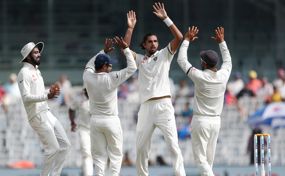 India's Ishant Sharma, second right, captain Virat Kohli, right, and their teammates celebrate the dismissal of England's Keaton Jennings during their first day of the fifth cricket test match in Chennai, India, Friday, Dec. 16, 2016. (AP Photo/Tsering Topgyal)
