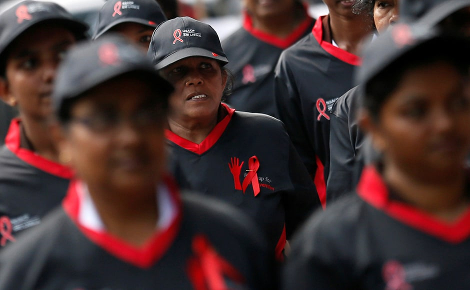 The WHO report stated that over 40 percent of people, numbering over 14 million, who have HIV are unaware of the condition. It states that one in seven people with human immunodeficiency virus (HIV) in Europe is unaware of their infection. A group of women took out a march during an event to mark the World AIDS day in Colombo, Sri Lanka. Reuters