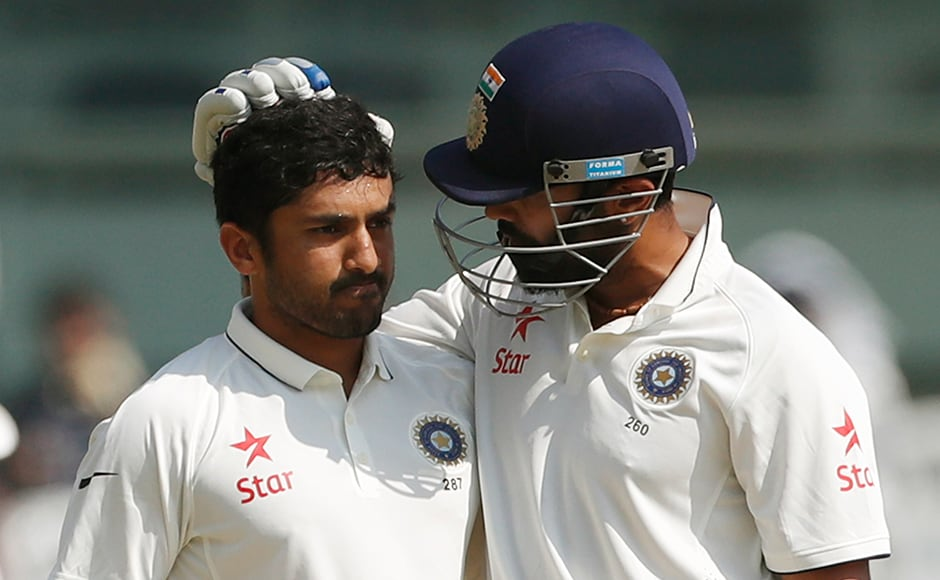 India's Murali Vijay, right, congratulates Karun Nair after scoring century against England during their fourth day of the fifth cricket test match in Chennai, India, Monday, Dec. 19, 2016. (AP Photo/Tsering Topgyal)