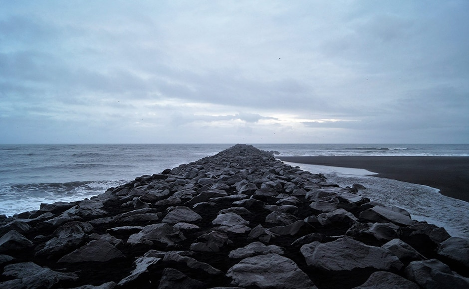 A dike leading into the sea. Photo credit: Alok Raj
