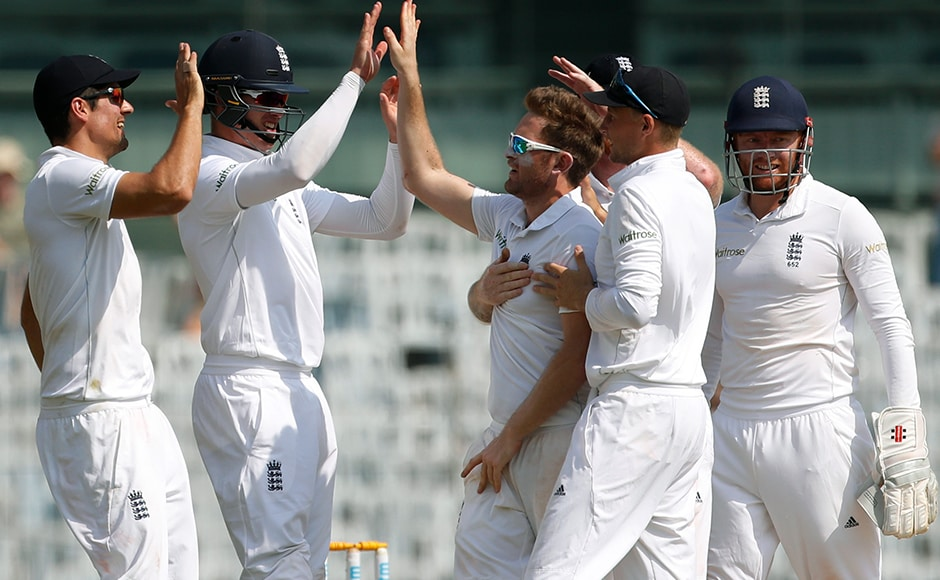 England's captain Alastair Cook, first left, Keaton Jennings, second left, Liam Dawson, centre, and Joe Root, second right, celebrates the dismissal of India's Murali Vijay during their fourth day of the fifth cricket test match in Chennai, India, Monday, Dec. 19, 2016. (AP Photo/Tsering Topgyal)