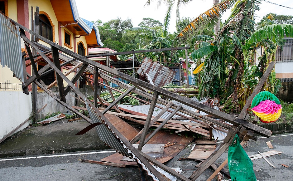 Officials said that Typhoon Nock-Ten had led to power crisis in five provinces as well as displacing thousands of villagers and travelers in Asia's Catholic bastion.(AP Photo)