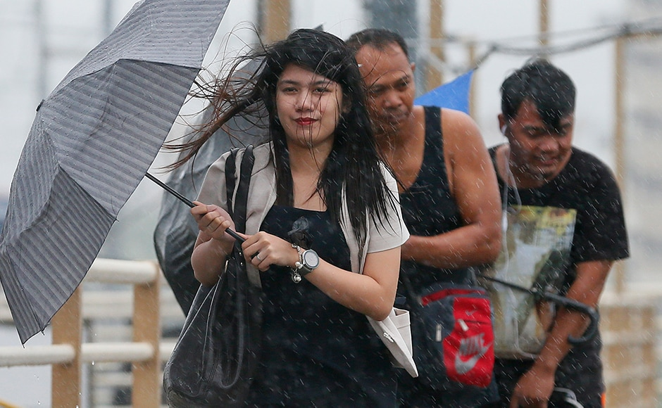 11,476 passengers, more than 1,000 cargo ships and over a dozen other vessels were stranded in various ports in the region, the Philippines National Disaster Risk Reduction and Management Council reported on Sunday.(AP Photo)